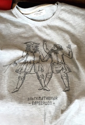 Awesome teeshirt line drawing of Peter cutting off the beard of an old school Russian man. Laos made in Russia. Double win.
