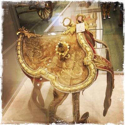 Diamonds on the edge of her saddle.
