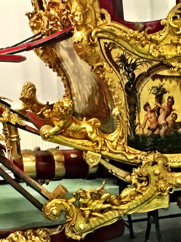 Detail; Figureheads. lions, and dolphins, oh my!